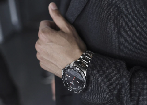 Swatch has released a smart watch with a branded OS and solar panel